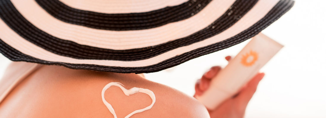 sunscreen heart on lady's shoulder - Green Beauty Expert