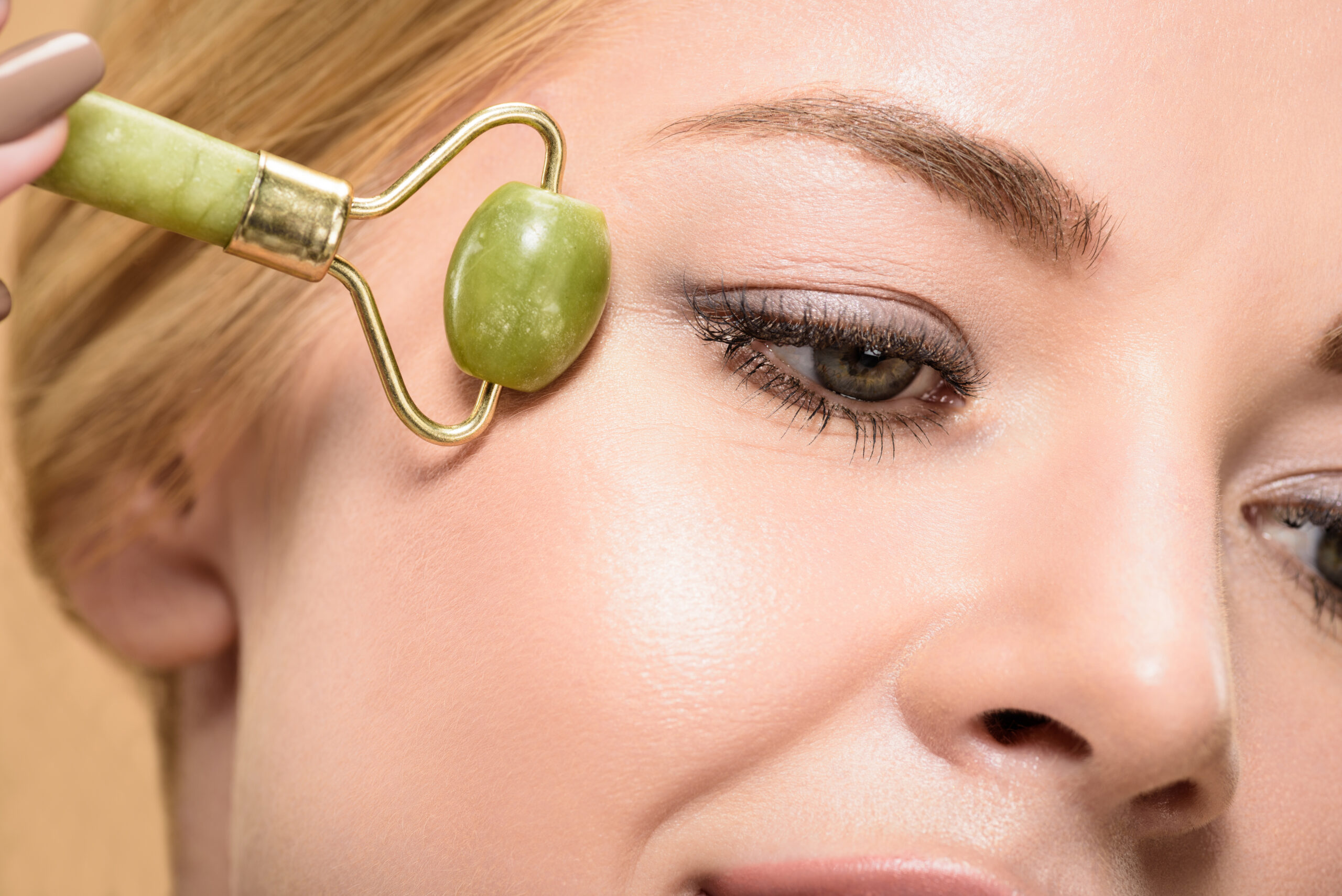 jade roller on woman's face